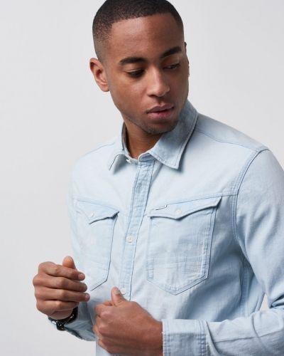 Till herr från G-Star, en jeansskjorta.