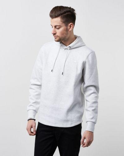 Till herr från G-Star, en vit hoodie.