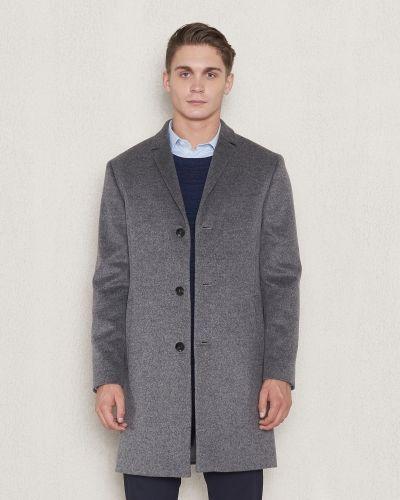 Till herr från Calvin Klein, en grå rock.