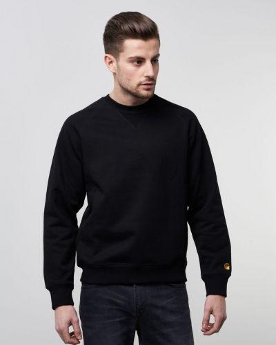 Till killar från Carhartt, en svart sweatshirts.