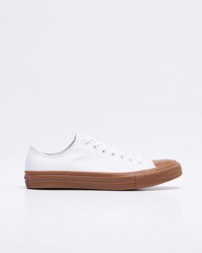 Till herr från Converse, en vit sneakers.