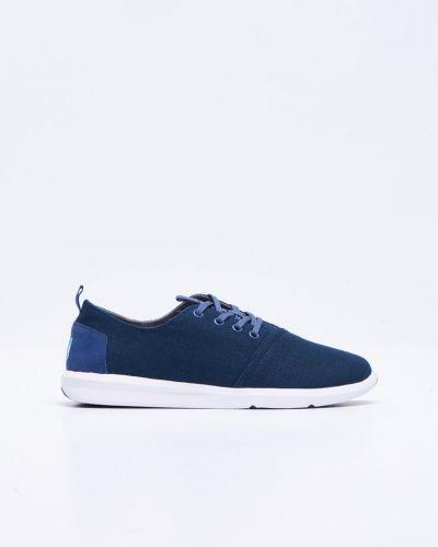 Till herr från TOMS, en blå sneakers.
