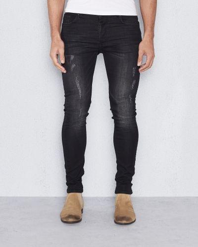 Till herr från Adrian Hammond, en jeans.