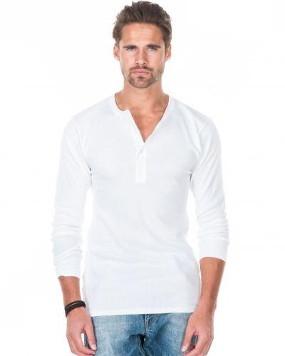 Till herr från Resteröds, en vit långärmad tröja.