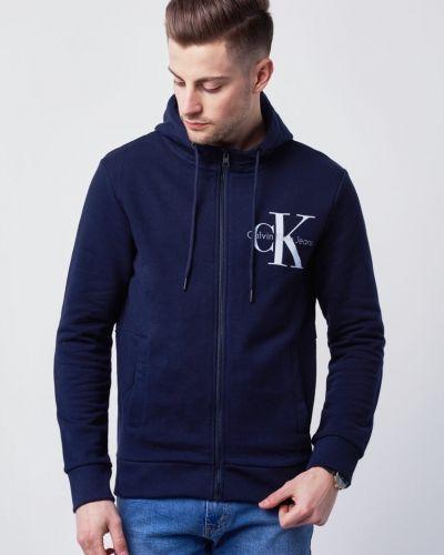 Till herr från Calvin Klein Jeans, en hoodie.