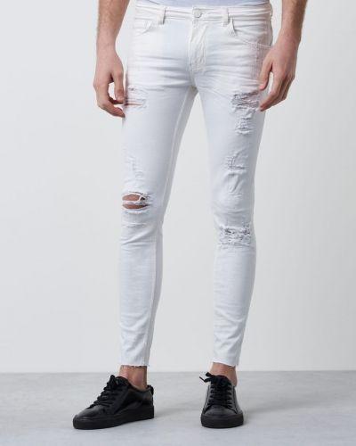Till herr från Gabba, en vit blandade jeans.