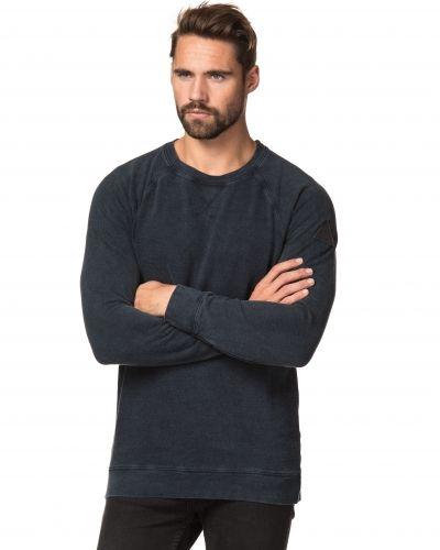 Till killar från Clay Cooper, en sweatshirts.