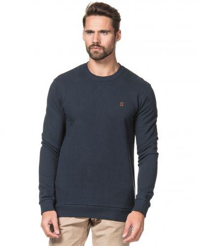 Blå sweatshirts från Les Deux till killar.