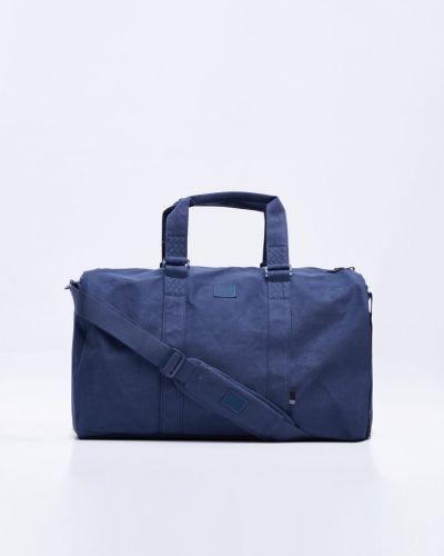 Till unisex från Herschel, en blå weekendbags.