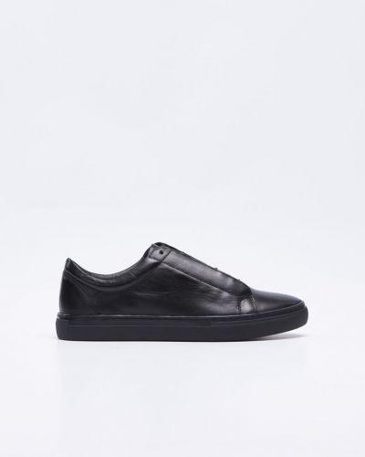 Till herr från Vagabond, en svart sneakers.