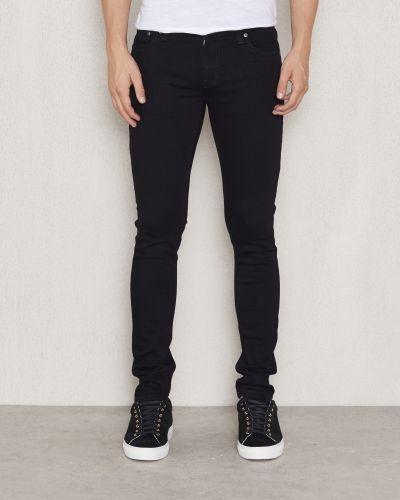 Till herr från Nudie Jeans, en svart slim fit jeans.