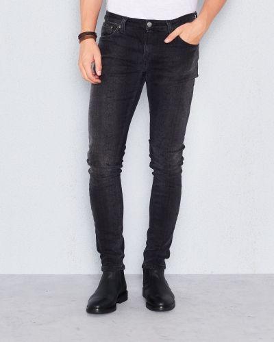 Skinny Dark Phyton Nudie Jeans slim fit jeans till herr.