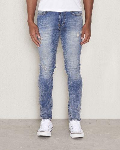 Till herr från William Baxter, en slim fit jeans.