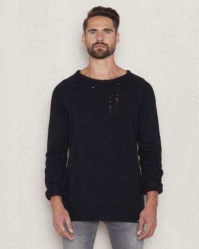 Till herr från William Baxter, en svart stickade tröja.