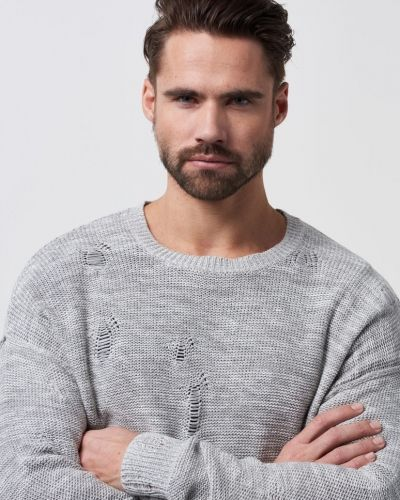 Stickade tröja från Adrian Hammond till herr.