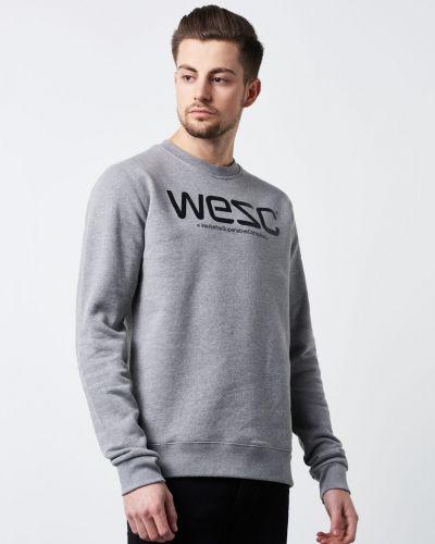 Till killar från WeSC, en grå sweatshirts.