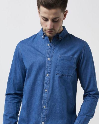 Till herr från Calvin Klein Jeans, en lila jeansskjorta.
