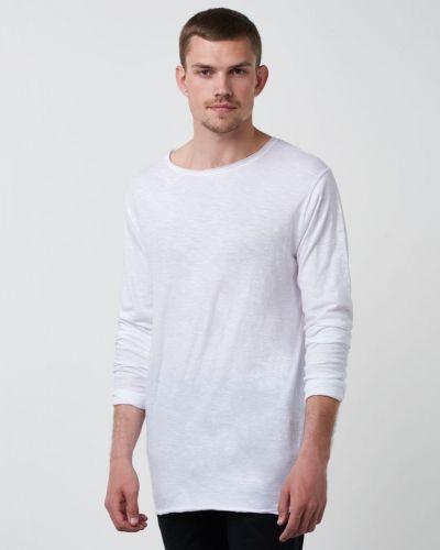Till herr från William Baxter, en vit långärmad tröja.