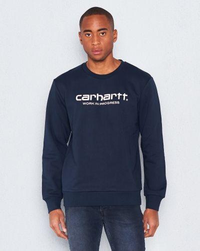 Till killar från Carhartt, en blå sweatshirts.