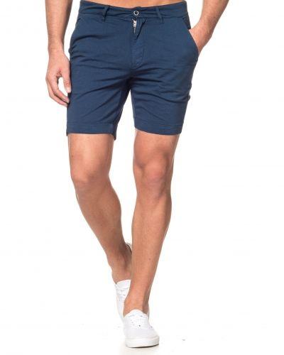 Till killar från Dr.Denim, en blå jeansshorts.