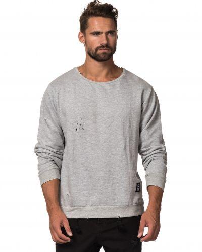 Till killar från Somewear, en sweatshirts.