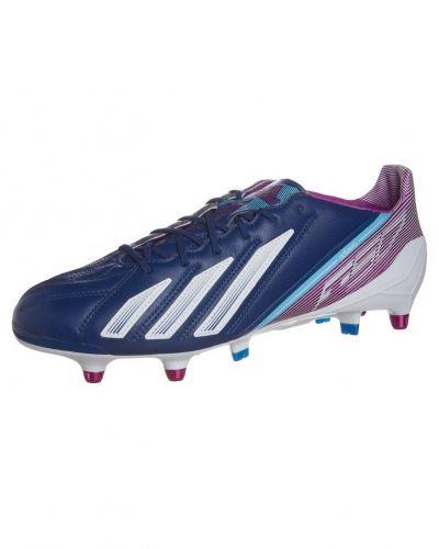 Adizero f50 xtrx sg lea fotbollsskor fasta dobbar från adidas Performance, Konstgrässkor