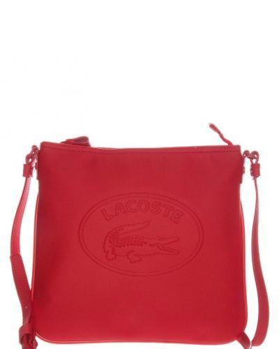 Lacoste Lacoste Axelremsväska Rött. Väskorna håller hög kvalitet.