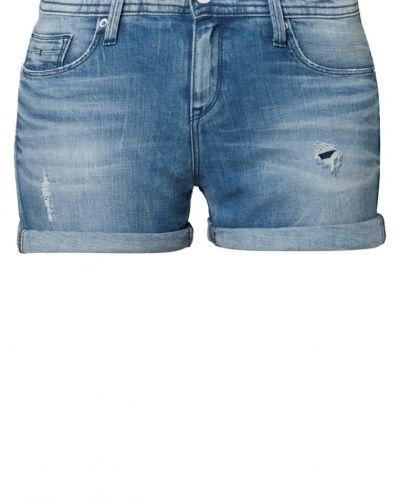 Till tjejer från Calvin Klein Jeans, en blå jeansshorts.
