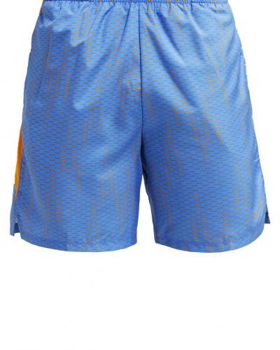 Challenger fuse träningsshorts light photo blue/vivid orange/reflective silver Nike Performance träningsshorts till dam.