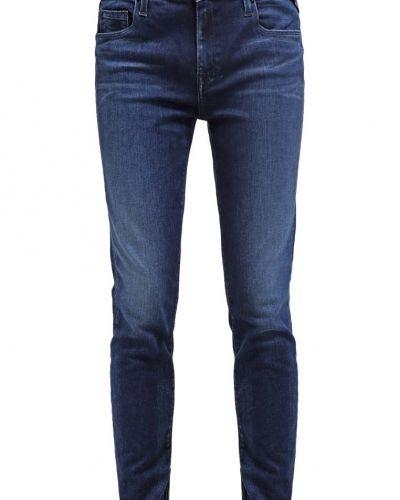 Till dam från Replay, en slim fit jeans.