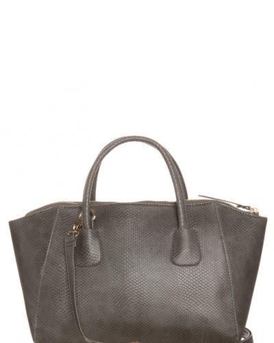 Dixie Deann handväska. Väskorna håller hög kvalitet.