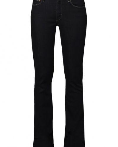 Till tjejer från Levi's®, en blå bootcut jeans.