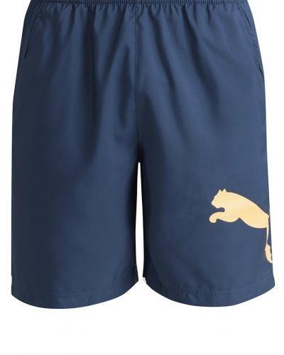 Essential träningsshorts blue wing teal/orange pop från Puma