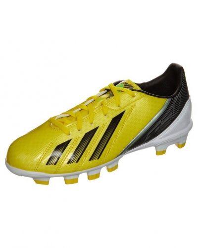adidas Performance adidas Performance F 10 TRX HG Fotbollsskor fasta dobbar Gult. Grasskor håller hög kvalitet.