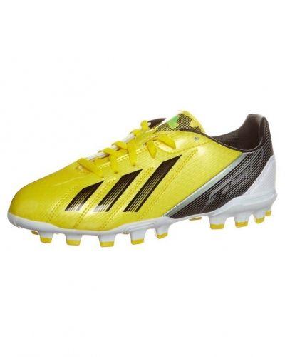 adidas Performance F10 TRX AG J Fotbollsskor fasta dobbar Gult från adidas Performance, Konstgrässkor