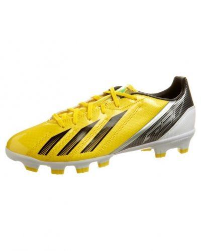 adidas Performance F10 TRX HG Fotbollsskor fasta dobbar Gult från adidas Performance, Konstgrässkor