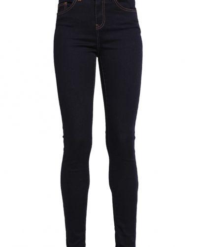 Slim fit jeans från UN JEAN till mamma.
