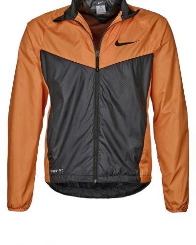 Nike Performance GPX WOVEN SIDELINE Outdoorjacka Orange från Nike Performance, Regnjackor