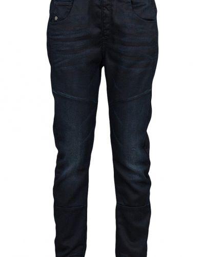 Till tjej från G-Star, en blå boyfriend jeans.