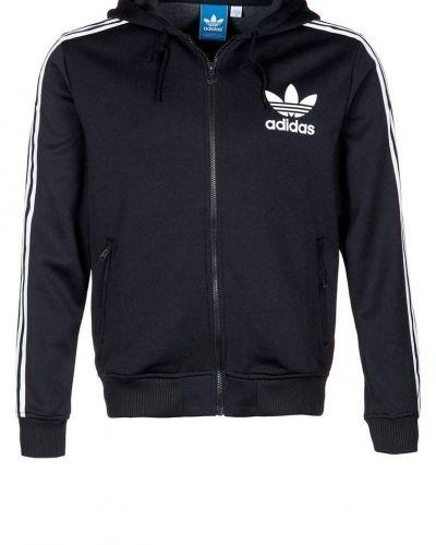 adidas Originals HOODED FLOCK Träningsjacka Svart från Adidas Originals, Träningsjackor