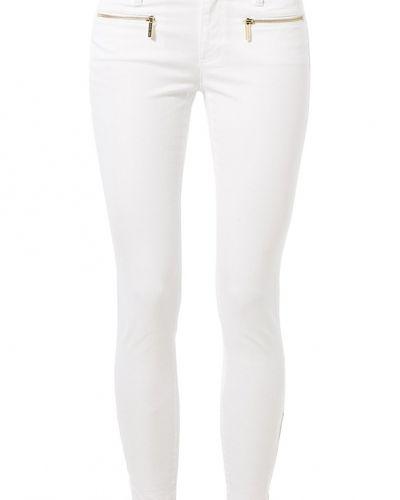 Till dam från MICHAEL Michael Kors, en vit slim fit jeans.
