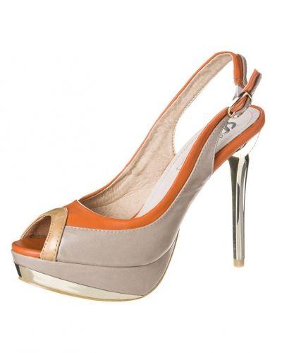 Till dam från Cassis côte d'azur, en beige högklackade sandal.