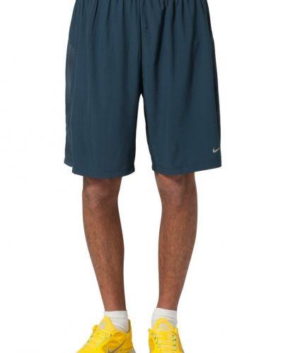 Nike Performance PHENOM 2IN1 Shorts Blått från Nike Performance, Träningsshorts