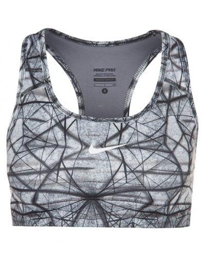 Nike Performance Nike Performance PRO PRINTED Sportbh Vitt. Traningsunderklader håller hög kvalitet.