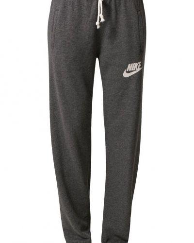Nike Sportswear Nike Sportswear RALLY Träningsbyxor Grått. Traningsbyxor håller hög kvalitet.