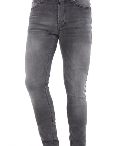 Slim fit jeans från Tigha till dam.