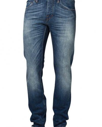 Till herr från Tiger of Sweden, en blå straight leg jeans.