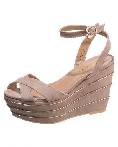 Beige högklackade sandal från Francesco Milano till dam.