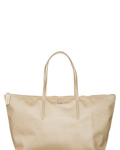 Lacoste Lacoste Shoppingväska Guld. Väskorna håller hög kvalitet.