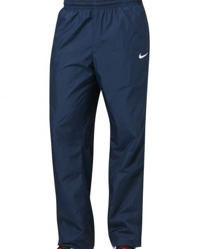 Nike Performance SIDELINE Träningsbyxor Blått från Nike Performance, Träningsbyxor med långa ben